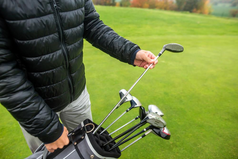 What distance does a hybrid golf club hit?
