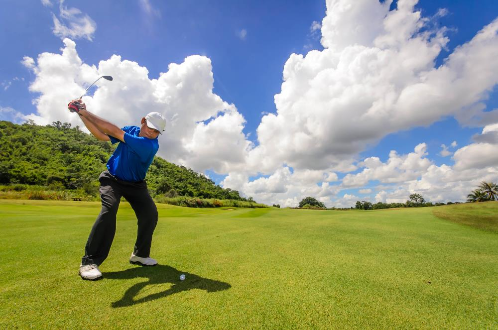 Strong golfer hitting for distance